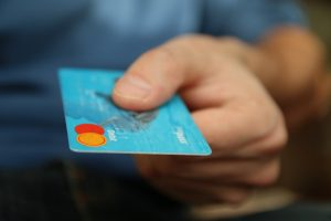person holding a card to make a purchase